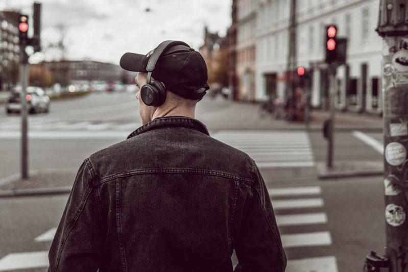 man walking headphones