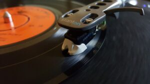 black and orange portable record playing