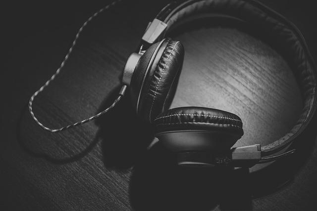 Black headphone on black surface