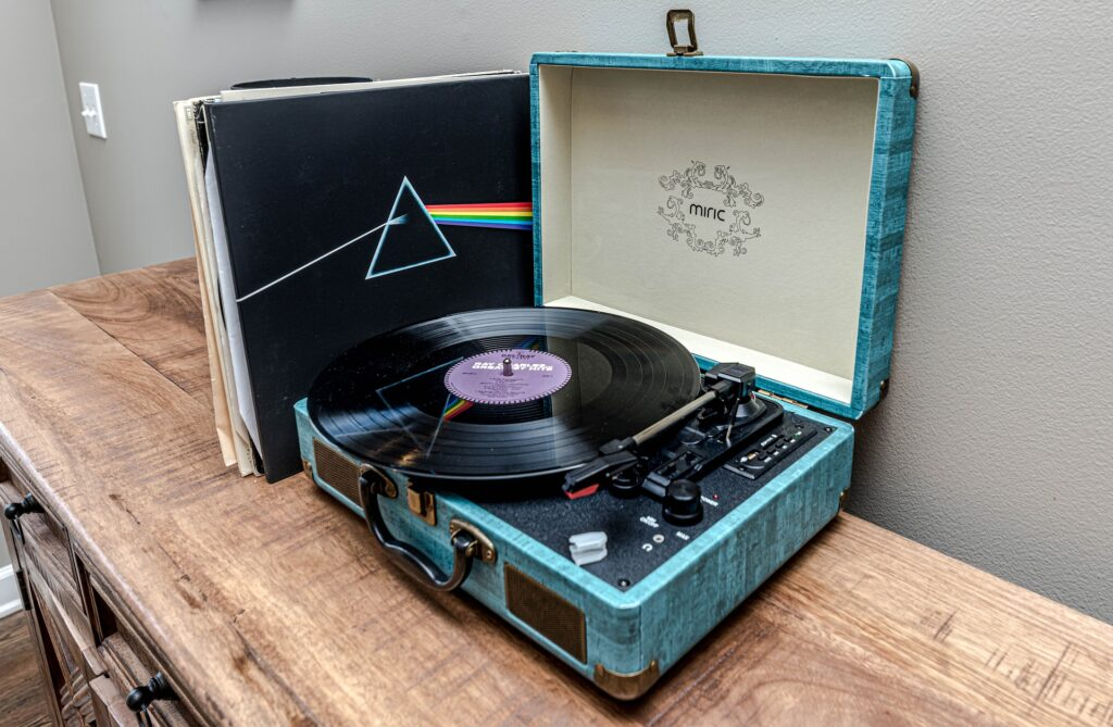 A record player and records that are not in record crates