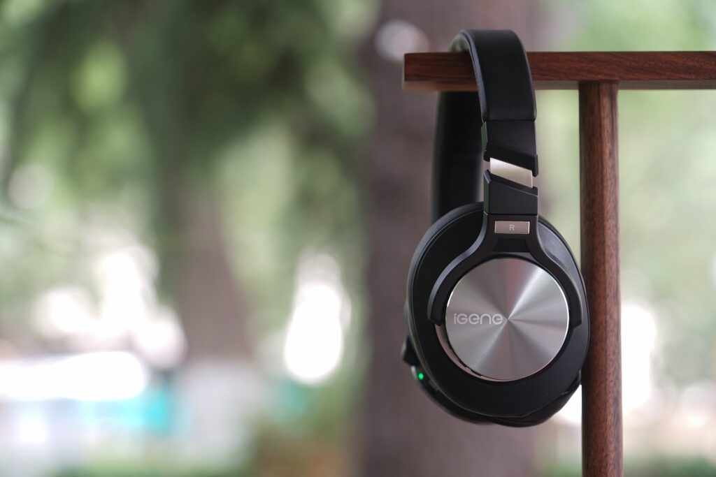 Headphones hanging on a wooden stand