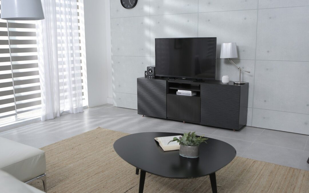 A modern living room with a TV and polk in-wall speakers